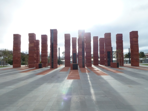 The Australian Memorial backlit by a moody winter sky